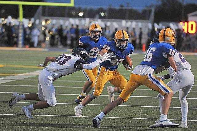 Max Smith stiff arms a defender.  Photo: Trib Live HSSN