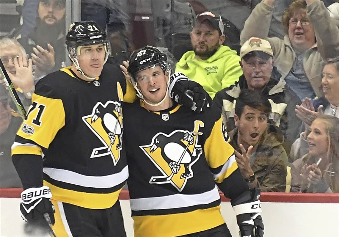 Malkin and Crosby celebrate after scoring a goal. Photo from the Pittsburgh Post-Gazette.