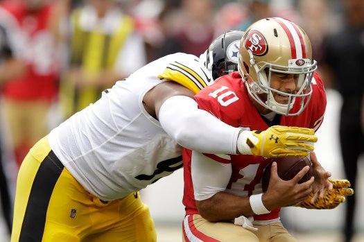 Pittsburgh Steelers defensive end Stephon Tuitt, left, sacks San Francisco 49ers quarterback Jimmy Garoppolo during the first half of an NFL football game in Santa Clara, Calif., Sunday, Sept. 22, 2019. (AP Photo/Ben Margot)
