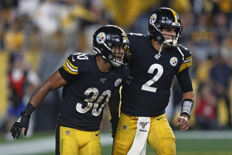Mason+Rudolph+and+James+Conner+celebrate+after+a+touchdown.+Photo+from+10TV